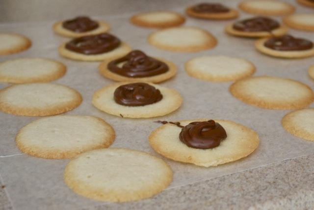 Chocolate piped onto homemade Milano cookies.