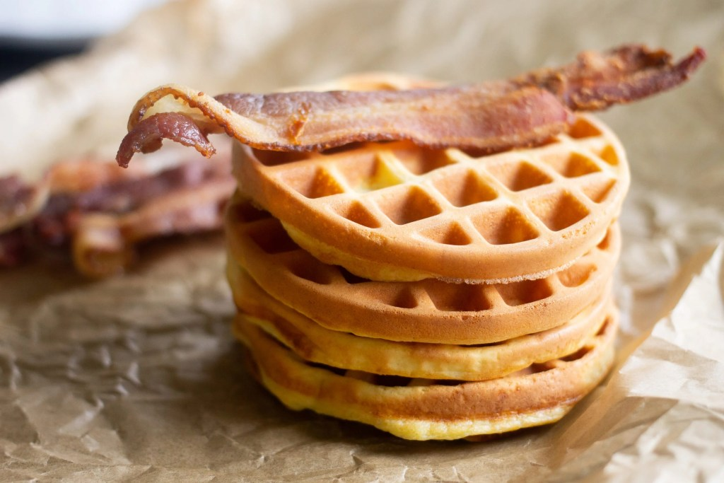 Keto chaffles with bacon on top, by Edible Times