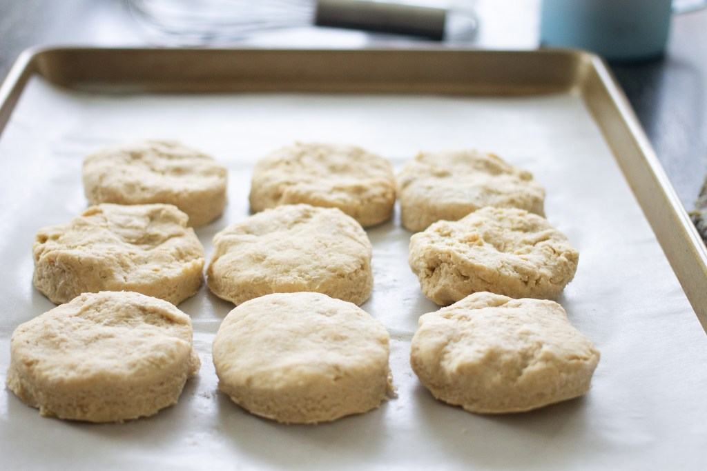 Unbaked biscuits on baking pan.