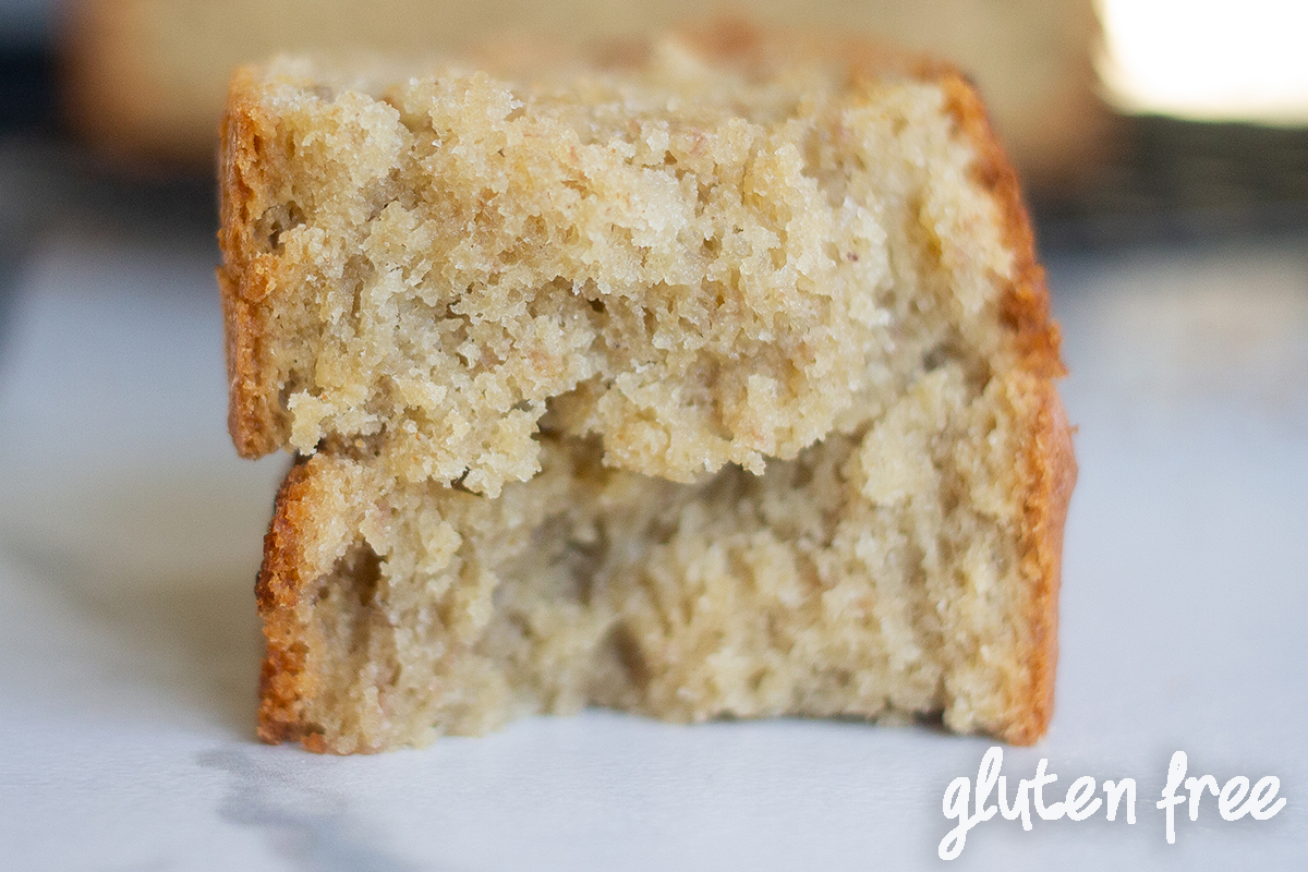 Broken in half slice of gluten-free banana bread with sour cream.