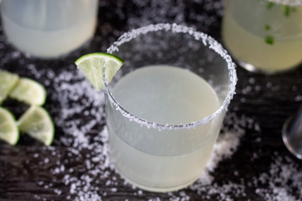 Authentic margarita on a dark counter.