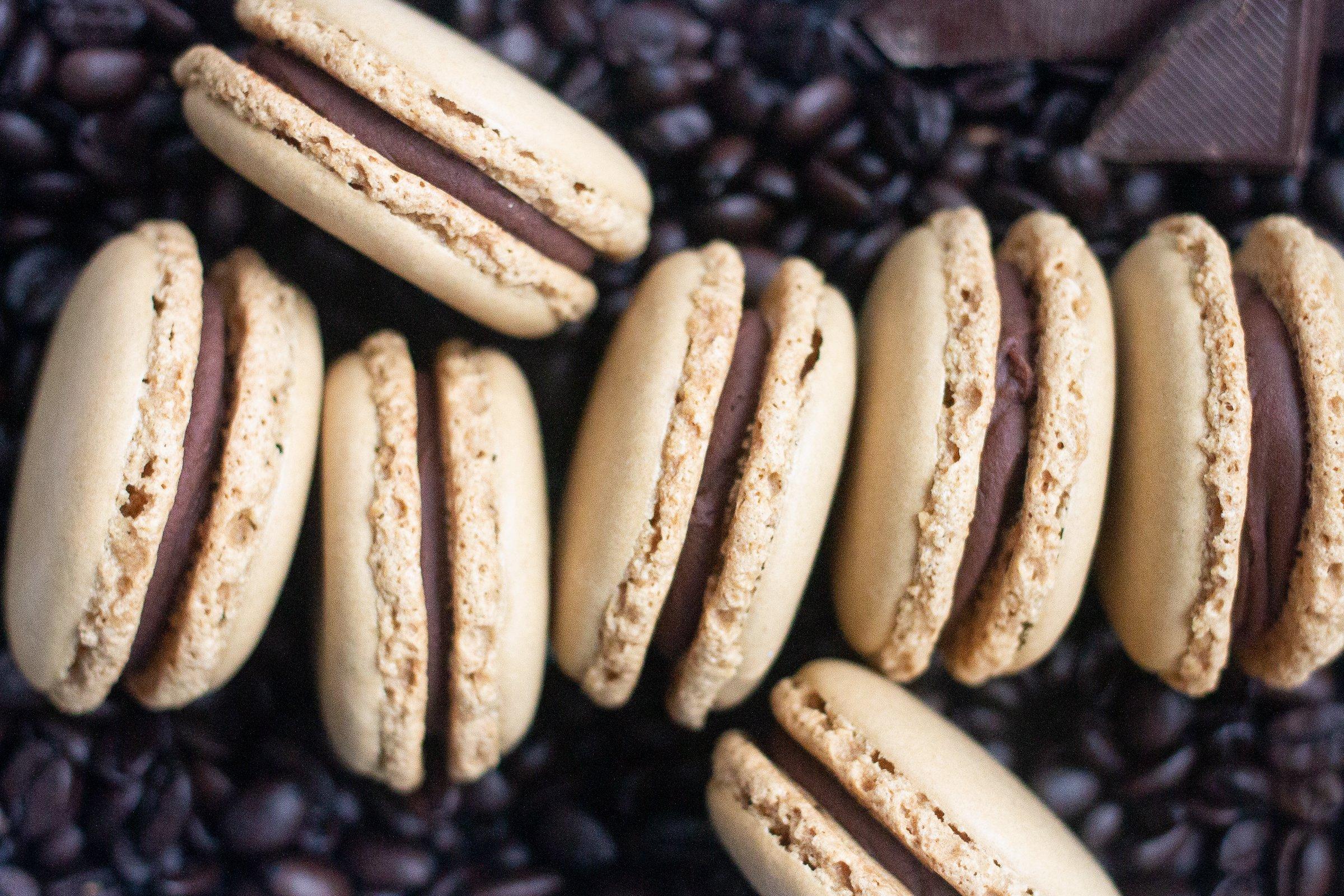 Mocha macarons on coffee beans