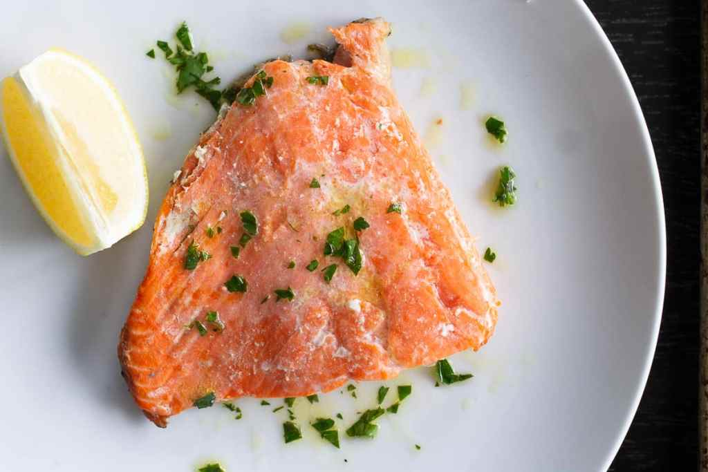 Grilled salmon on a plate with lemon vinaigrette
