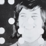 Susan Sontag at Andy Warhol's factory in 1964. Still frame from Susan Sontag's screen test featuring sprocket holes over her image.