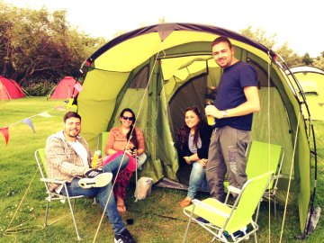 Happy group in the 4 Person Pre-pitched Tents
