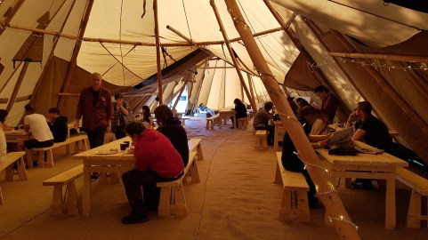Guests enjoying breakfast inside the Giant Tipi
