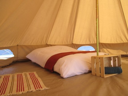 Inside our Bell Tents for two guests. Towels are available for hire at reception.