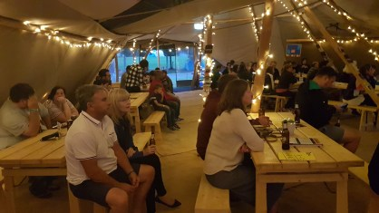 Guests enjoying the performers in the tipis