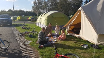 Happy campers chilling by their tent