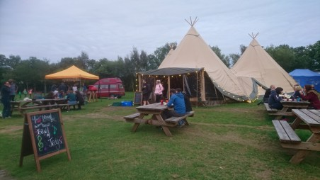 A warm evening outside the tipis with freshly made pizzas