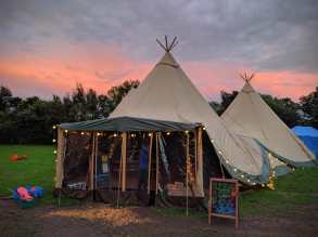 The Giant Tipis are the main social area on the campsite, with daily breakfast, an all-day cafe and licenced bar as well as board games, Fringer performances and quiz nights