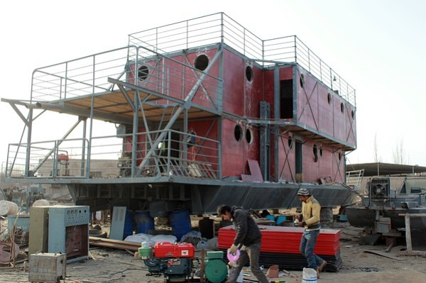 This photo taken on November 24, 2012 shows the unfinished boat built by Lu Zhenhai, a man from Urumqi, Xinjiang Uyghur Autonomous Region, afraid that his home would be submerged in a doomsday flood in 2012.  Lu said he was worried that the apocalypse would happen in 2012, so he decided to invest all his money, about 160,500 USD into building what he hopes will be his own indestructible ark.   (STR/AFP/Getty Images)