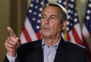US House Speaker John Boehner speaks to the media outside his office on Capitol Hill in Washington (Yuri Gripas/REUTERS)