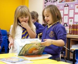Primary One Children enjoying their free books during Book Week Scotland 2013 Credit: Scottish Book Trust