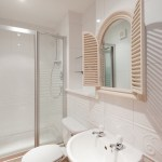 Master Ensuite shower room in sparkling whites