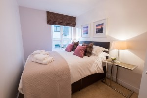 The McDonald Residence double bedroom in mauve tartan