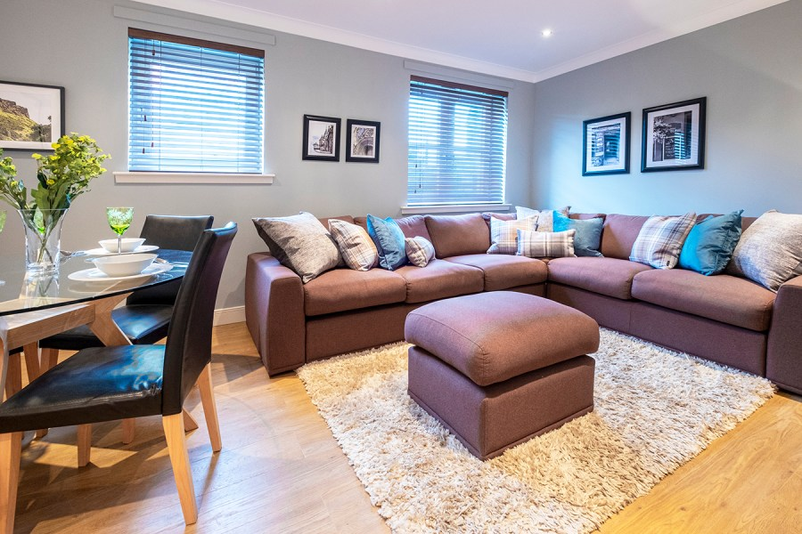 stylish comfortable living and dining room blues and neutrals holiday apartment edinburgh near Royal Mile