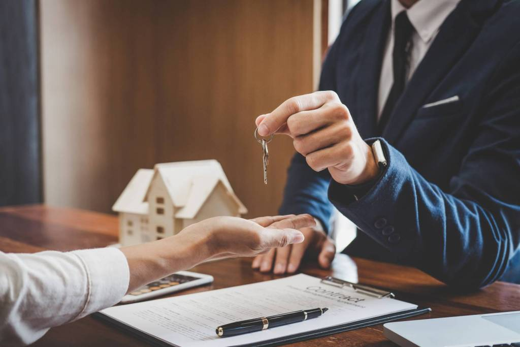 Canva Real Estate Agent Sales Manager Holding Filing Keys To Customer After Signing Rental Lease Contract Of Sale Purchase Agreement Concerning Mortgage Loan Offer For And House Insurance