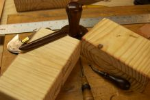 Wooden forms and some tools for making leather boxes.