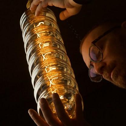 6 Watt dimmable filament LED amber glass long disc globe