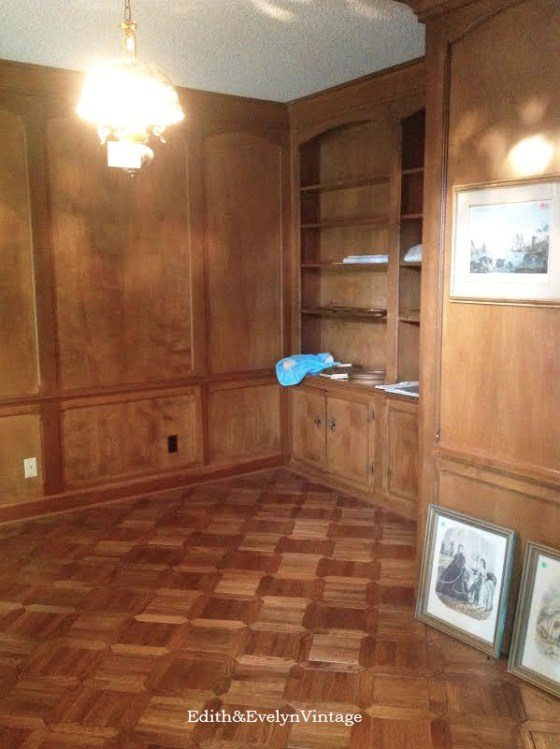 Wood paneled study with original parquet floor.