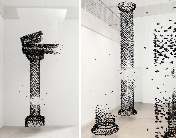 Suspended Charcoal Columns Depict The Relationship Between