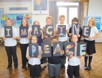 Pupils from St Mary's Primary School prepare for their history project on John Lennon and the Beatles.