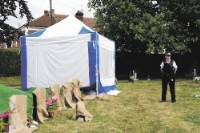 EXHUMED Police at Kingston Cemetery where David Lace was buried