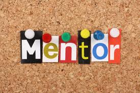 The word Mentor on a corkboard
