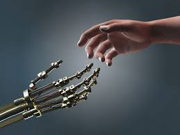 picture of a human hand and a robot hand working with a real person