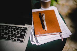 laptop pens and paper for manuscript appraisals