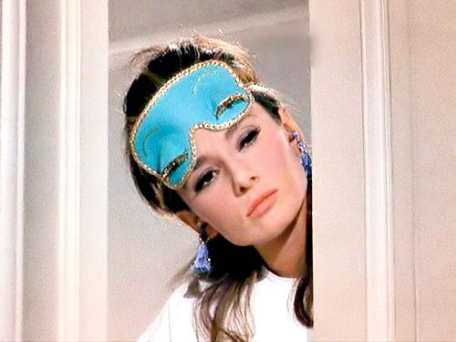 Audrey Hepburn peeking through the door