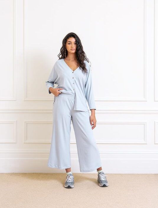 woman wearing a loungewear set from the brand Sidia