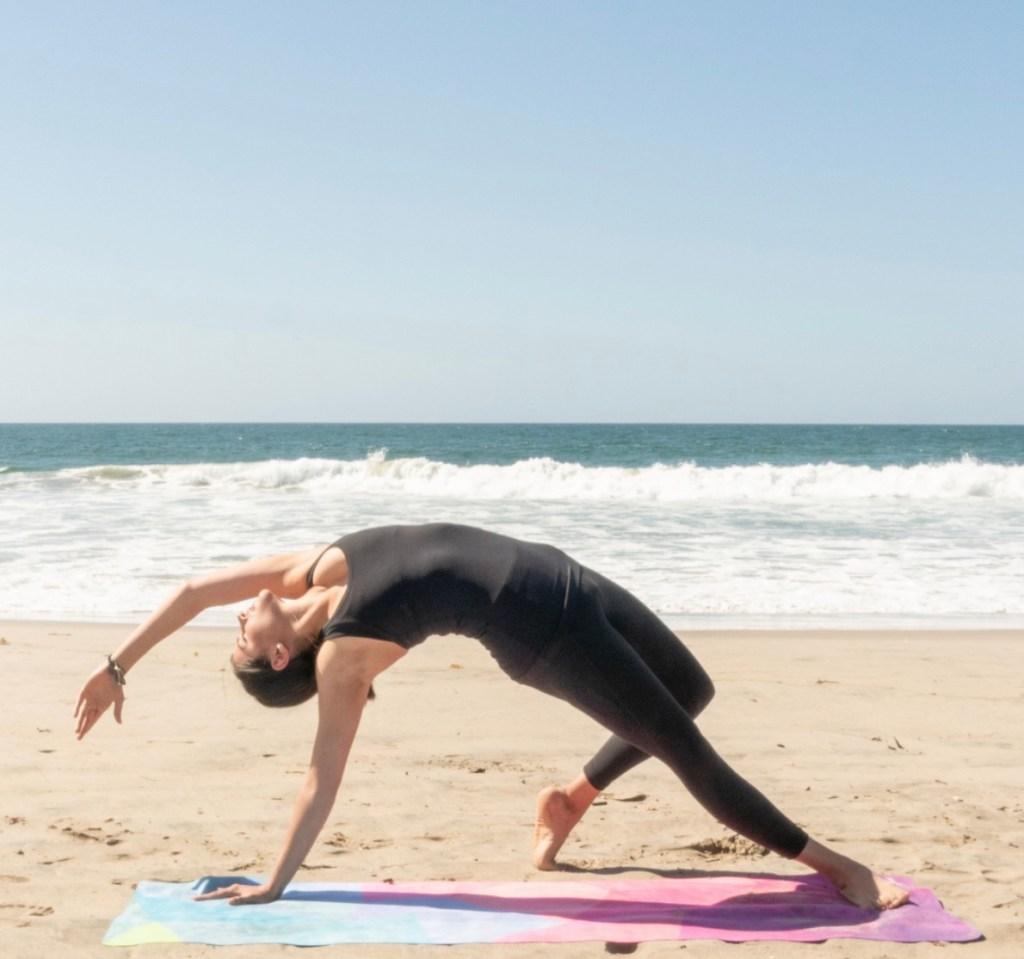 Sarah Beth doing yoga by the beach