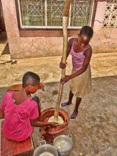 Girls pounding fufu