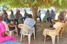 Meeting under mango tree