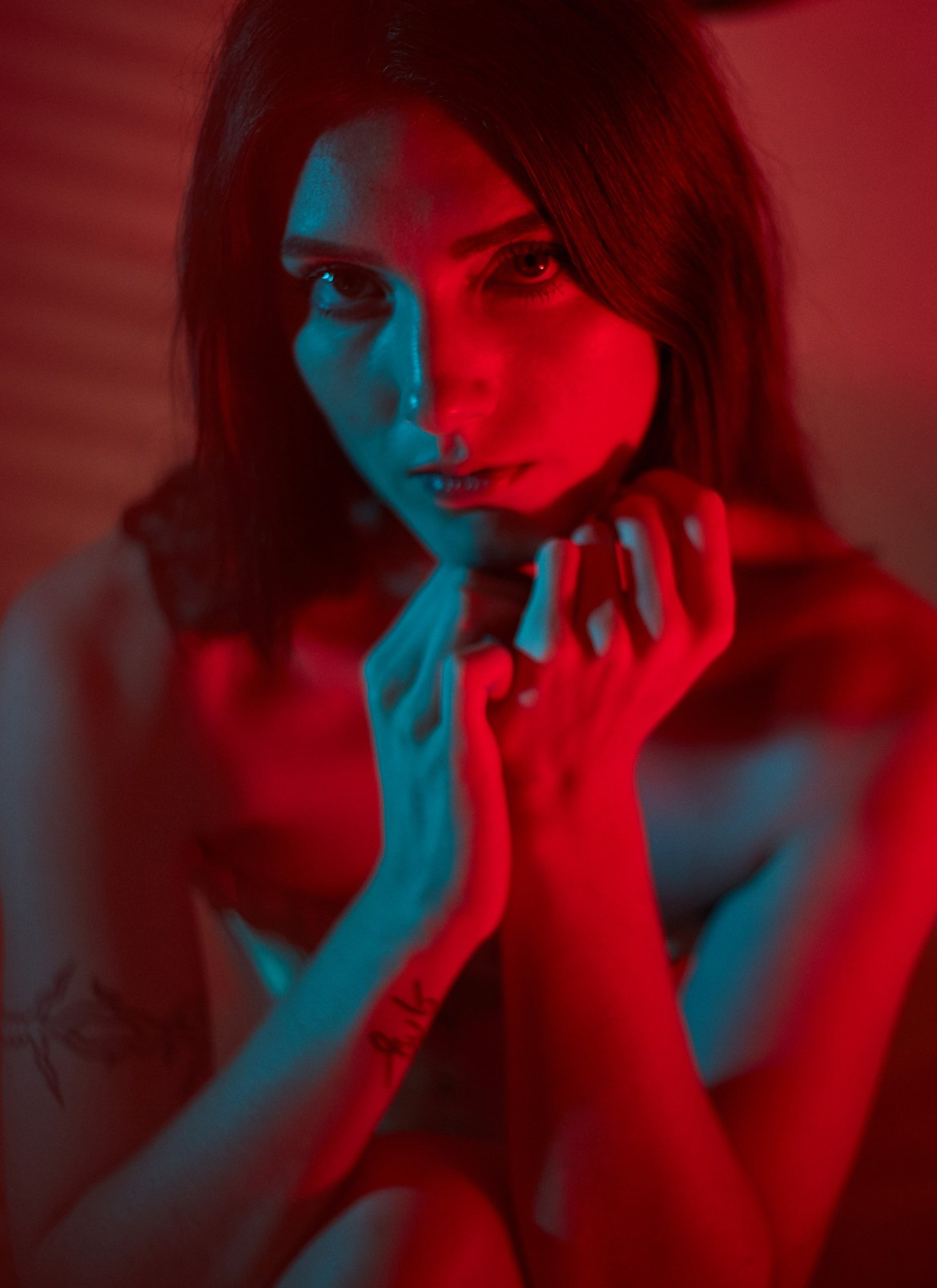 portrait of beautiful woman with red and cyan color gel lighting
