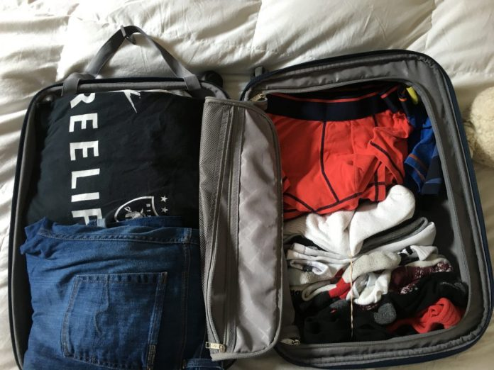 Pack your clothes like so...don't mind my undies though.