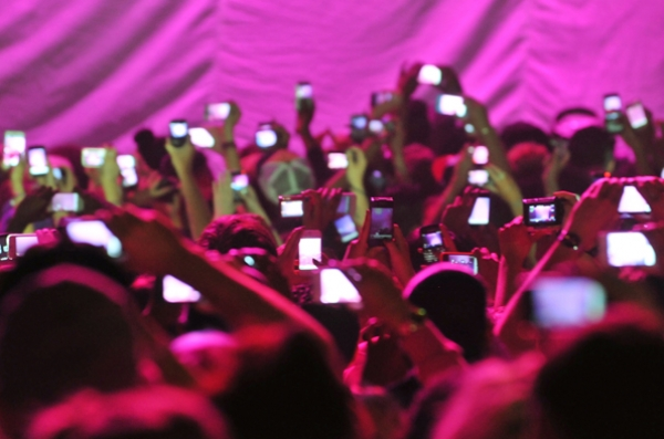 People holding cell phones at concerts