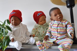 These three baby dolls at Kuujjuaq's Tulattavik health centre each represent a different health scenario: the baby on the left shows features of an infant exposed prenatally to drugs, the baby on the right shows features of fetal alcohol spectrum disorder (FASD), while the baby in the middle is considered healthy. A family coordinator based at the health centre uses those dolls to do FASD awareness and prenatal education for young families in the Nunavik community