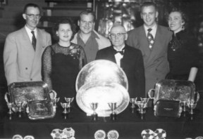 1954 Trophy Table with Marg and Wally Jacob, 2nd and 3rd from left. Marg and Wally were instrumental in the shows and events of the Club for decades.