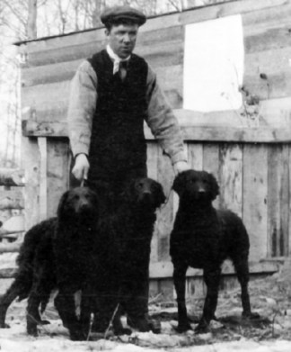Joe Caswell, one of EKC's founding members, with some of his Curly Coated Retrievers in 1913.