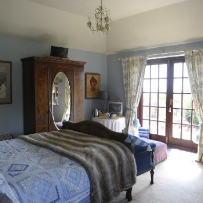 Blue bedroom with french doors