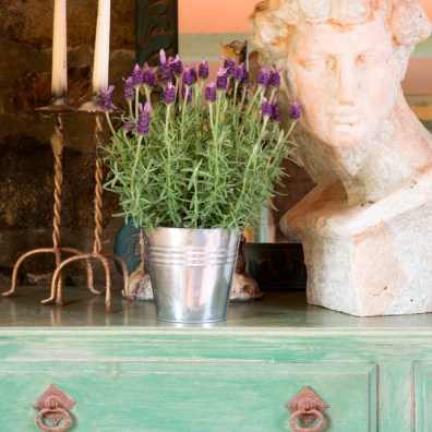 Distressed painted sideboard and greek bust
