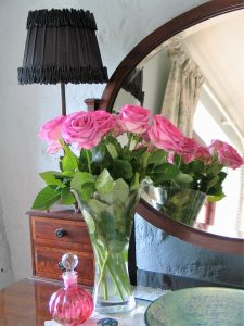 Ednovean Farm has a modern take on vintage style and pretty personal touches such as fresh roses in the bedrooms