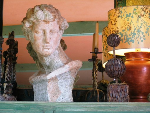 The heavy bust in the Garden room is really a stone garden ornament