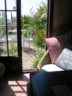 The Garden room opens to a terrace bright with flowers