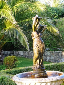 Fountain framed by Date palms in Cornwall