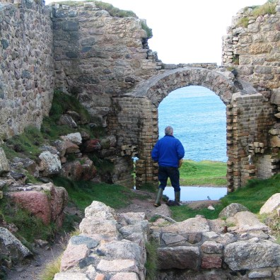 We clambered down through one of the ruined buildings towards the sea
