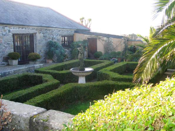 Formal parterre in old farmyard